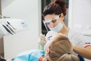 woman getting cosmetic dentistry services in West U texas