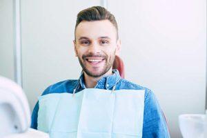 happy man receiving general dentistry services