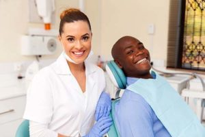 man receiving teeth cleaning services
