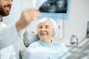 woman learning about restorative dentistry