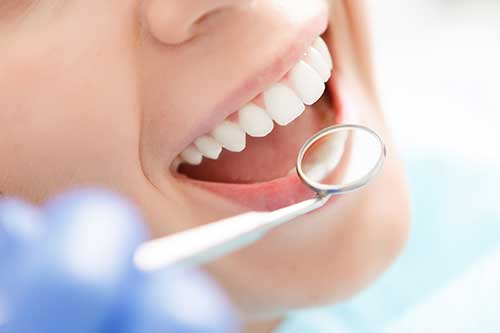 woman gets teeth whitening services